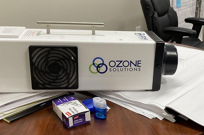 Ozone Solutions ozone machine sitting on a desk.