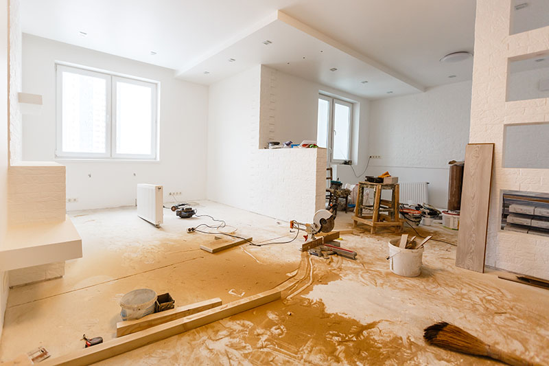 Interior of a white apartment clearly under renovation.